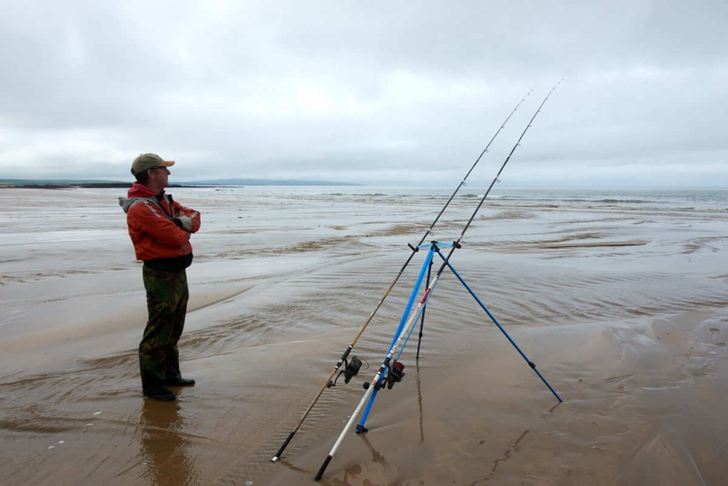 Fishing on a beach with fixed spool reels